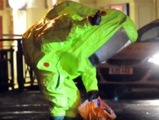 Police wearing hazmat gear gather evidence where former Russian spy Sergei Skripal was found after being poisoned by unidentified attackers using a military-grade chemical weapon. Screengrab from BBC news coverage. 9march2018