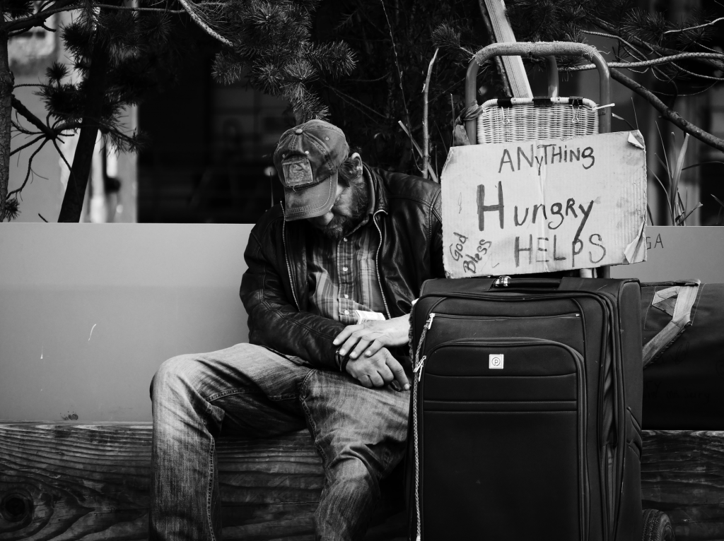A beggar and his sign
